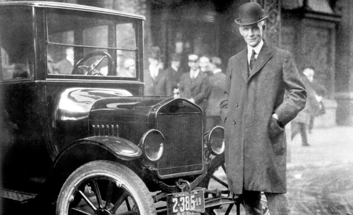 Henry Ford with a Ford Model T.